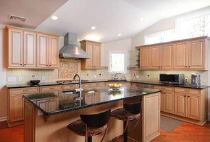 Modern Kitchen with Large Ceramic Tile, Simple granite counters, L-shaped, Breakfast bar, Undermount sink, Kitchen island