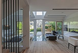 Modern Great Room with Skylight, Glass door, Custom dividing wall, Style selections embossed pine wood planks sample