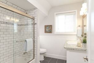 Traditional Full Bathroom with tiled wall showerbath, Sterling Karsten Toilet - White, Complex granite counters, Wainscotting