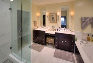 Contemporary Master Bathroom with Corian counters, Undermount sink, Double sink, Wall sconce, frameless showerdoor, Flush