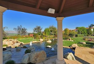 Mediterranean Landscape/Yard with Premier Acoustics PA-6AW Indoor/Outdoor Speaker Pair, exterior stone floors, Fence, Pond