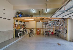 Traditional Garage with flush light, Chair rail, Loft, specialty door, Box ceiling, High ceiling, Concrete floors