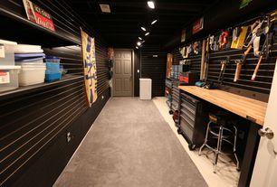 Modern Garage with flush light, Carpet, Concrete floors, Built-in bookshelf
