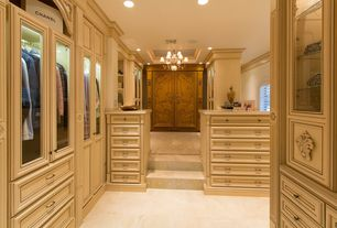 Traditional Closet with can lights, French doors, stone tile floors, Painted cabinets, Crown molding, limestone tile floors