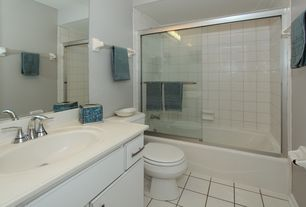 Traditional Full Bathroom with European Cabinets, Inset cabinets, Corian counters, Undermount sink, limestone tile floors