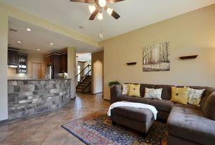 Traditional Great Room with specialty door, Built-in bookshelf, sandstone floors, Ceiling fan