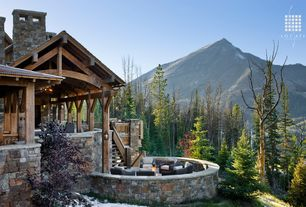 Rustic Exterior of Home with Pathway, Stone exterior, Round seating area with fire pit, exterior stone floors, Fire pit