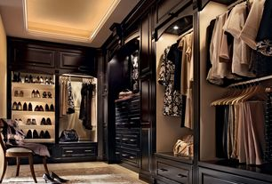 Closet with Crown molding, stone tile floors, Shoe storage, limestone tile floors, Standard height, Paint 1, can lights