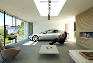 Contemporary Garage with Built-in bookshelf, Concrete floors, Skylight