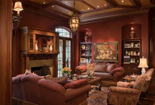 Traditional Living Room with stone fireplace, Box ceiling, Arched window, Fireplace, Wall sconce, Pendant light, can lights