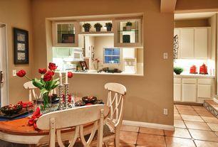 Dining Room with sandstone tile floors, Built-in bookshelf