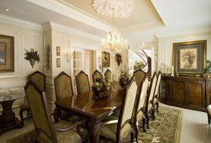 Traditional Dining Room with Crown molding, Wall sconce, Chandelier, Standard height, can lights, Chair rail, French doors