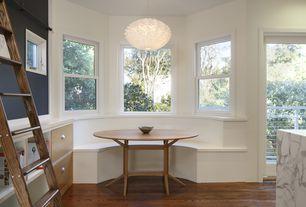 Contemporary Dining Room with flush light, Window seat, Built-in bookshelf, Hardwood floors