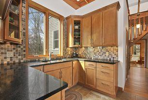 Craftsman Kitchen with Stonemark Granite-Granite Countertop in Absolute Black, Complex granite counters, Ceramic Tile