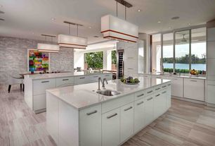Modern Kitchen with Corian-solid surface countertop in bisque, European Cabinets, Wine refrigerator, Flush, Pendant light