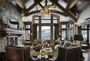 Contemporary Living Room with French doors, Chandelier, Arched window, Hardwood floors, stone fireplace, High ceiling
