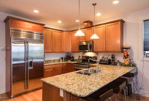 Traditional Kitchen with Hardwood floors, Flush, U-shaped, Raised panel, High ceiling, Complex Granite, Breakfast bar