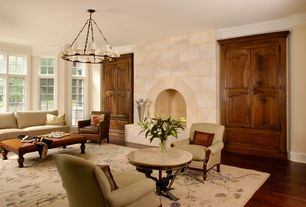 Traditional Living Room with Chandelier, Crown molding, Louvered door, Laminate floors, Wainscotting