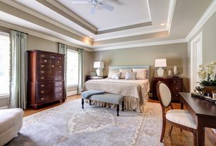 Traditional Master Bedroom with Ceiling fan, Built-in bookshelf, Hardwood floors, Crown molding