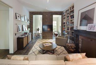 Traditional Living Room with Built-in bookshelf, specialty door, Hardwood floors