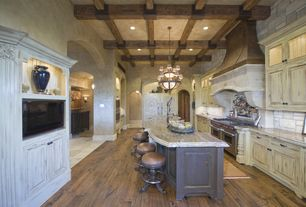 """Traditional Kitchen with Regal Copper Vent Hood, Wolf 60"""" gas range - 6 burners, french top, Exposed beam, Chandelier"""