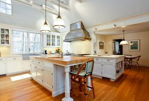 Cottage Kitchen with Simple marble counters, Wood counters, French doors, Flat panel cabinets, Breakfast nook, can lights