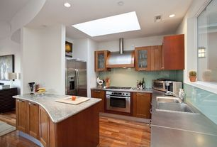 Contemporary Kitchen with Flat panel cabinets, Simple granite counters, L-shaped, electric cooktop, Multiple Sinks, wall oven