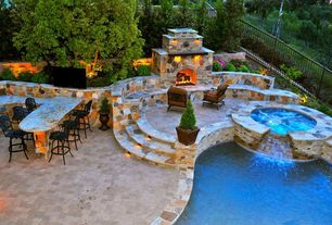 Mediterranean Patio with Deck Railing, Outdoor stone fireplace, exterior stone floors, Outdoor seating, Pool with hot tub