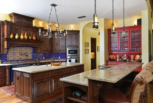 Eclectic Kitchen with Custom hood, Paint 2, Kitchen island, Iron pendant light, U-shaped, L-shaped, wall oven, Glass panel