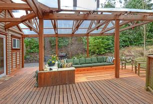 Rustic Deck with Built-in seating, Clear polycarbonate panels, Raised beds, Outdoor kitchen, Custom built-in seating, Fence