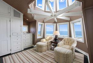 Cottage Master Bedroom with Hardwood floors, Crown molding, Skylight, Built-in bookshelf, specialty door, Exposed beam