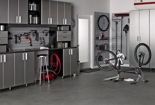 Contemporary Garage with Concrete floors, Built-in bookshelf, Obscured glass panel door, Ulti-mate starfire storage systems