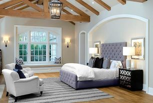 Traditional Master Bedroom with Pendant light, Wall sconce, Exposed beam, Window seat, Hardwood floors, can lights, Casement