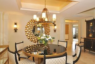 Traditional Dining Room with Wall sconce, sandstone floors, Chandelier