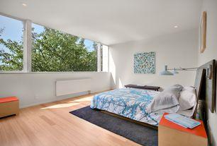 Contemporary Master Bedroom with Hardwood floors, Safavieh Shag Dark Grey Area Rug, Ausint duvet - blue