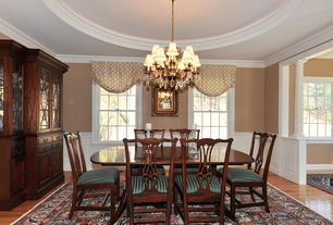 Traditional Dining Room with Crown molding, Wainscotting, Columns, Hardwood floors, Chandelier, Chair rail
