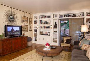 Eclectic Living Room with Crown molding, Hardwood floors, Wall sconce, sliding glass door, Standard height