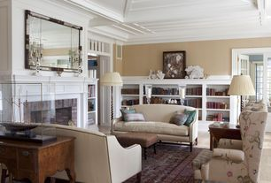 Traditional Living Room with Cement fireplace, Crown molding, Built-in bookshelf, Box ceiling, Transom window, French doors