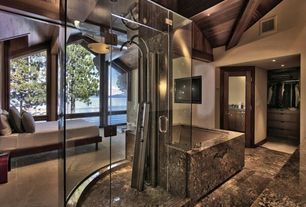 Contemporary Master Bathroom with High ceiling, flush light, Exposed beam, frameless showerdoor, stone tile floors, Bathtub