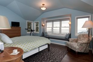 Guest Bedroom with Wall sconce, Window seat, Hardwood floors, flush light