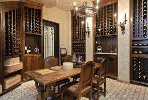 Mediterranean Wine Cellar with Chandelier, Wall sconce, French doors, Built-in bookshelf, Brick floors