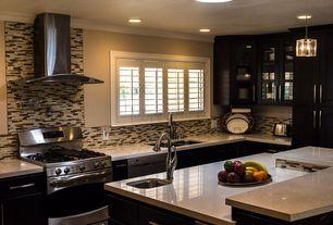 Contemporary Kitchen with gas range, Standard height, L-shaped, dishwasher, Flush, Undermount sink, Casement, Wall Hood