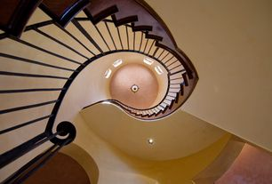 Mediterranean Staircase with Hardwood floors, Cathedral ceiling, flush light