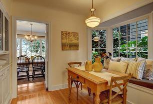 Cottage Dining Room with Pendant light, Bay window, Built-in bookshelf, Hardwood floors, Window seat