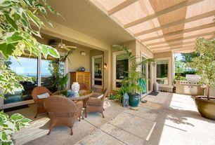 Tropical Porch with sliding glass door, picture window, exterior concrete tile floors, Outdoor kitchen, Fence