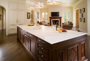 Traditional Kitchen with Flat panel cabinets, French doors, Fireplace, Complex marble counters, Standard height, One-wall