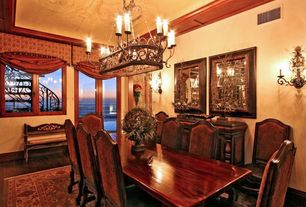 Traditional Dining Room with Wall sconce, French doors, Hardwood floors, Crown molding, Chandelier, Standard height, Casement