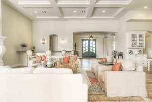 Traditional Great Room with Hardwood floors, French doors, Built-in bookshelf, Wall sconce, Columns, Pendant light