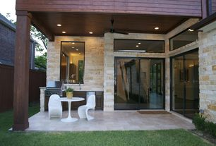 Contemporary Patio with Fence, exterior tile floors, Transom window, Outdoor kitchen, exterior terracotta tile floors