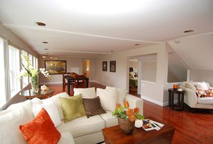 Contemporary Great Room with double-hung window, Hardwood floors, Standard height, can lights, Wall sconce